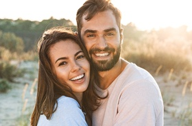 Happy, smiling couple enjoying benefits of tooth-colored fillings