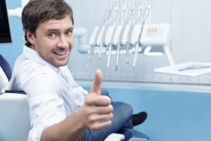 Happy man at appointment to maximize dental insurance benefits